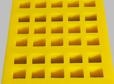 A piece of mosaic connection type polyurethane screen mesh on the gray background.