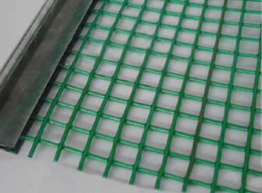 A piece of green steel core polyurethane screen on the gray background.