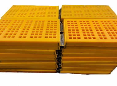 Two stacks of tensioned polyurethane screens with metal hooks.