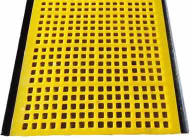 A piece of yellow tensioned polyurethane screen with urethane hooks.
