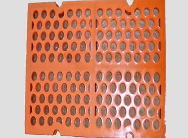 A piece of orange modular polyurethane screen mesh with round holes.