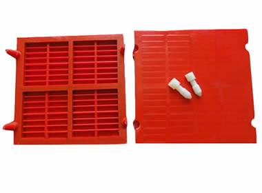 Two pieces of red polyurethane dewatering screens with two rose nail on them.