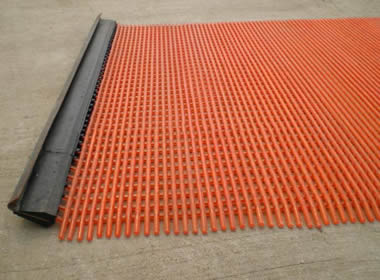 A piece of orange steel core urethane screen with urethane hook.