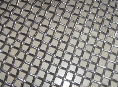 A piece of plain weave woven vibrating screen mesh on the ground.