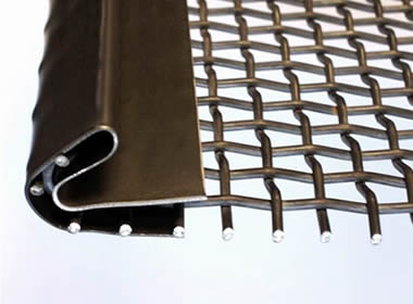 A piece of woven vibrating screen mesh with metal sheet hook on the gray background.